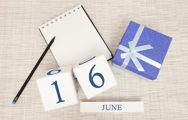 Kalender mit trendigem blauem text und zahlen für den 16. juni