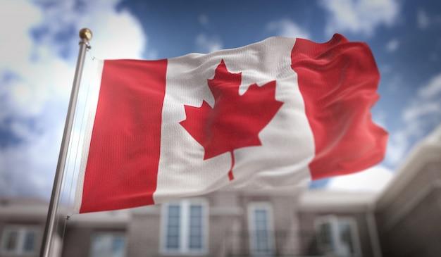 Kanada-flagge 3d-rendering auf blauem himmel gebäude hintergrund