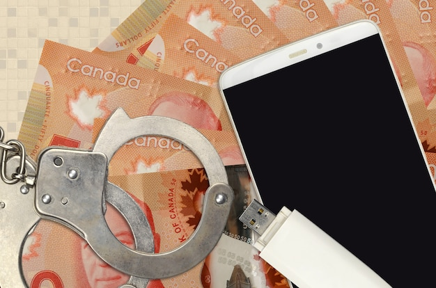 Kanadische dollarnoten und smartphone mit polizeihandschellen