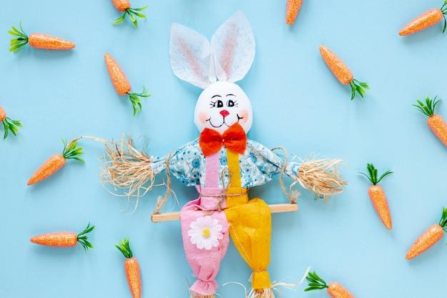 Kaninchendekorationen mit rahmen von karotten
