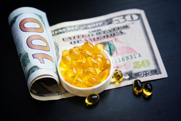 Kapseln mit fischöl und dollars