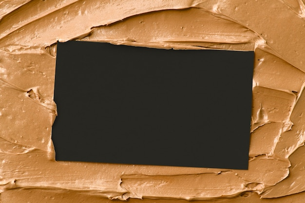 Karamell-zuckerguss-textur-hintergrund mit visitenkarte