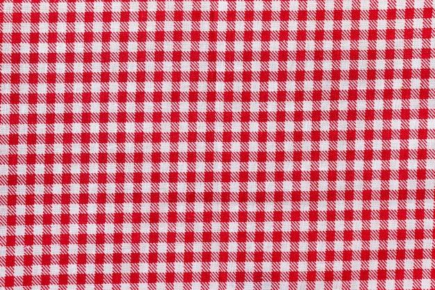 Karierte stoffstruktur des roten und weißen stoffes
