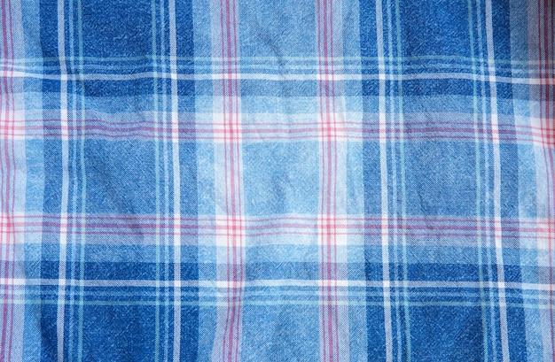 Karierte stoffstruktur. quadrate auf textil. hintergrund aus natürlichen stoffen.