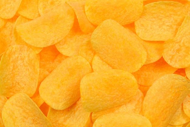 Kartoffelchips snack textur hintergrund. draufsicht.