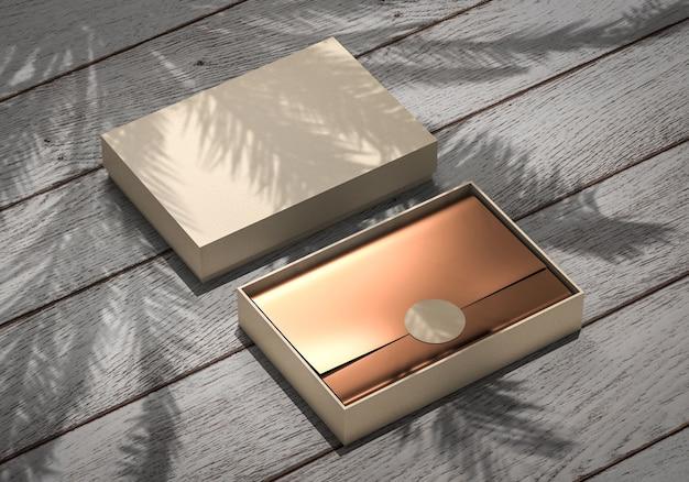Kastenbehältermodell mit goldenem verpackungsfolienpapier auf hölzerner schreibtischrohlingschablone, 3d rendern