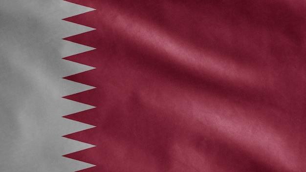 Katar flagge weht im wind. nahaufnahme von katar vorlage weht, weiche und glatte seide. stoff stoff textur fähnrich hintergrund