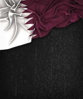 Katar-flagge weinlese auf einer grunge-schwarzen tafel mit raum für text