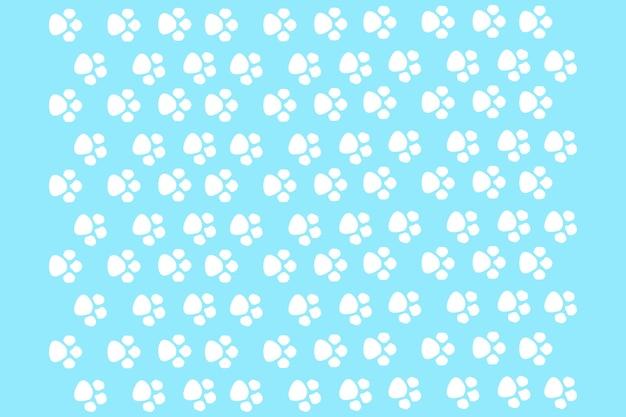 Katzenpfoten auf blauem hintergrund, nahtloses muster für printdesign