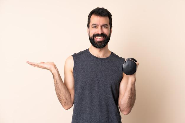 Kaukasischer sportmann mit bart, der gewichtheben macht