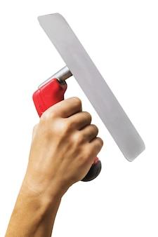 Kelle in der hand isoliert auf weißem hintergrund hand angehoben hält ein bauwerkzeug