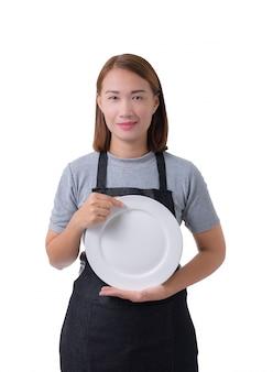 Kellnerin, lieferfrau oder service-frau im grauen hemd und in der schürze