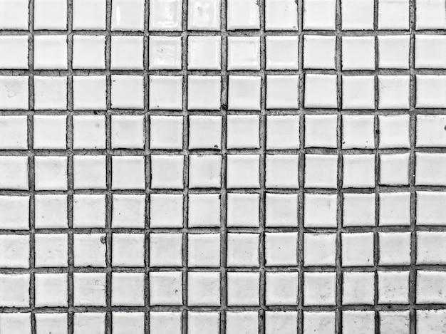 Keramikfliesen. schwarzweiss des abstrakten hintergrunds. minimalismus architektur. details des modernen musterbaus.