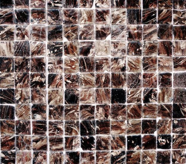 Keramikziegel-wand verkratztes hintergrund-beschaffenheits-konzept
