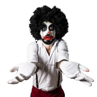 Killer-clown mit handschellen