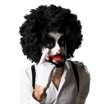 Killer-clown zeigt etwas