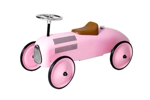 Kinder rosa spielzeugauto isoliert auf weißem hintergrund