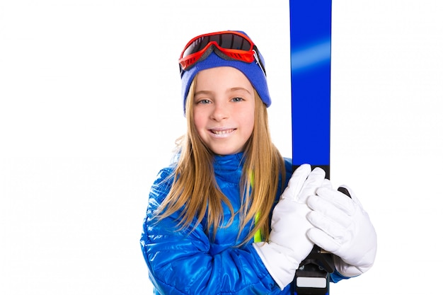 Kindermädchenski mit schneeschutzbrillen und winterhut