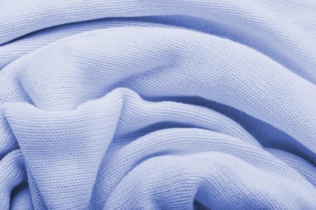Klassische blaue strickstoffwollebeschaffenheit für hintergrund. nahaufnahme des blauen strickmaterialmusters für design.