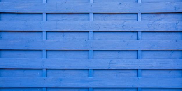 Klassischer blauer holzhintergrund des hölzernen hintergrunds der träger mit glänzender oberfläche