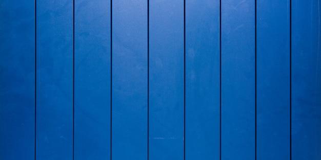 Klassischer blauer licht glänzender hölzerner schreibtischbeschaffenheit abstrakter hintergrund