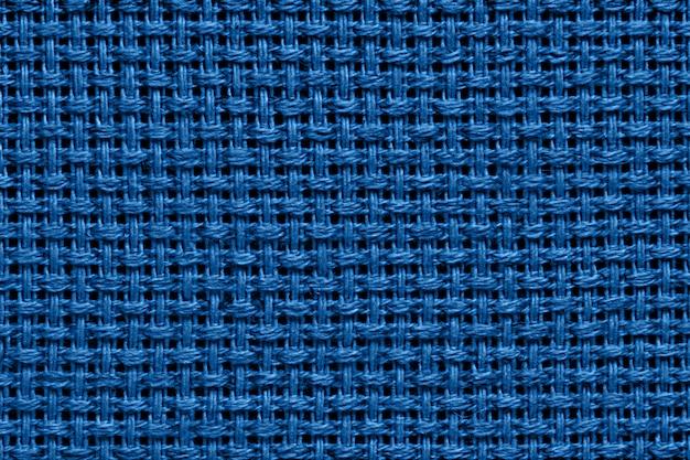 Klassischer blauer stoffbeschaffenheitshintergrund