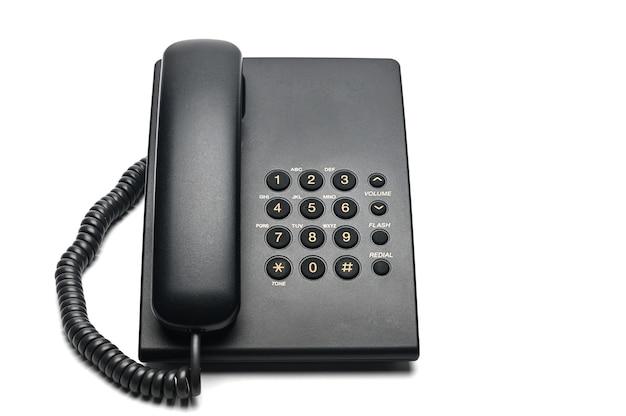 Klassisches verdrahtetes telefon auf einem weißen isolierten hintergrund
