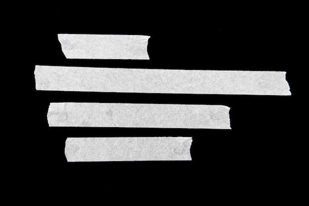 Klebebänder, weiße klebebänder isoliert auf schwarzem hintergrund