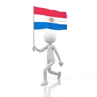 Kleine person, die mit paraguay-flagge in einer hand geht. 3d-rendering-bild