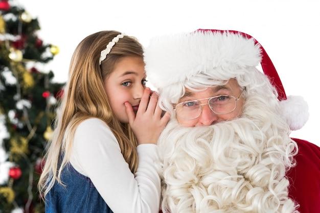 Kleines mädchen, das weihnachtsmann ein geheimnis telling ist