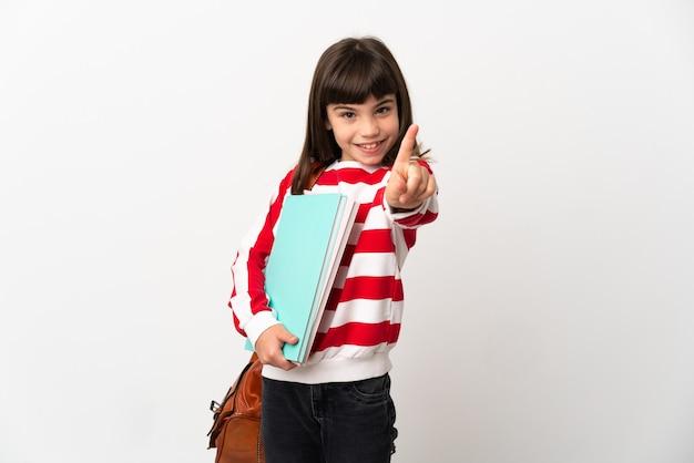 Kleines studentenmädchen isoliert auf weißem hintergrund, das einen finger zeigt und anhebt