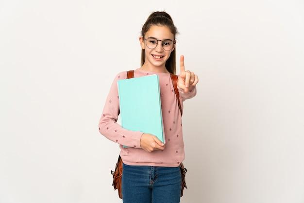 Kleines studentenmädchen über isolierter wand, die einen finger zeigt und hebt