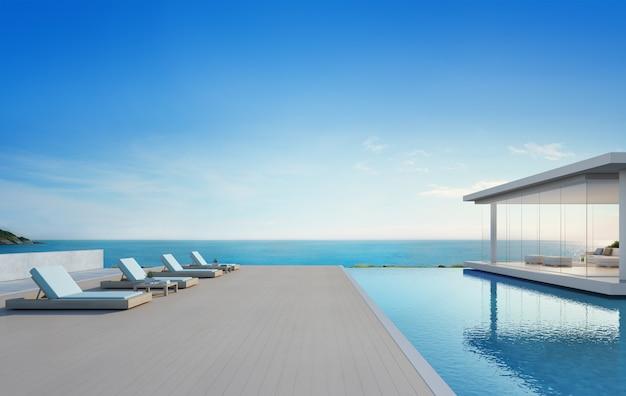 Klubsessel auf bretterbodenplattform am ferienhaus oder am hotel.
