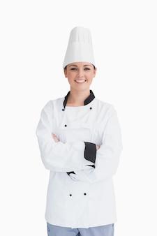 Koch, der einen chefhut trägt