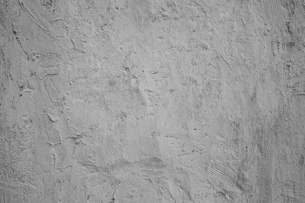 Körniger hintergrund mit kleinen rissen und strichen