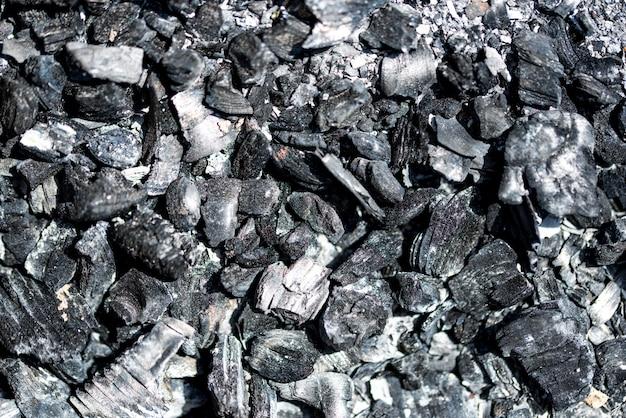 Kohlenmineralschwarzes als würfelsteinhintergrund. kohle-muster