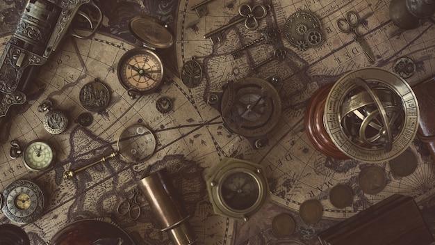 Kompass mit altem sammlerstück auf karte der alten welt