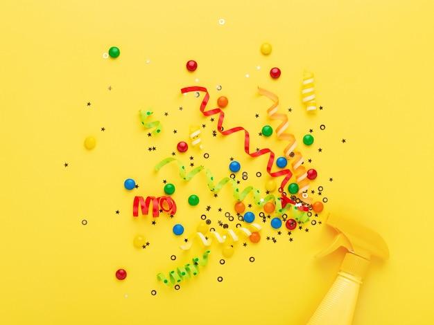 Konfetti auf gelb sprühen