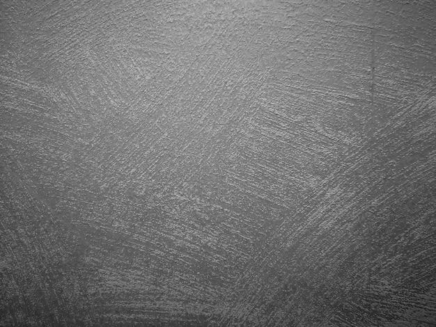 Konkreter schwarzer hintergrund der wand für weinleseart