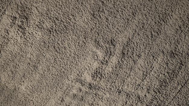 Konkreter zementhintergrund und schmutzige robuste und gezackte raue textur.