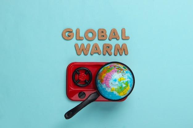 Konzept der globalen erwärmung. globus in der pfanne auf dem herd. blau