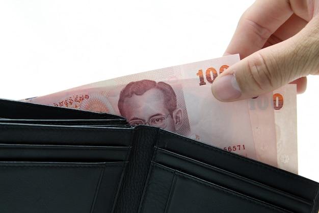 Konzept von heben geld von der geldbörse auf