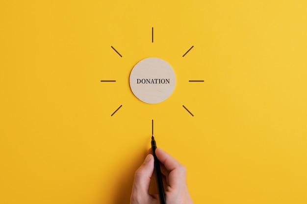Konzeptionelles bild von wohltätigkeit und spende