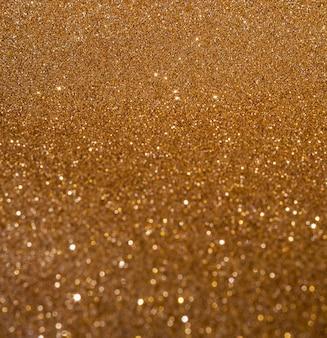 Kopieren sie raum glänzend unscharfen goldhintergrund