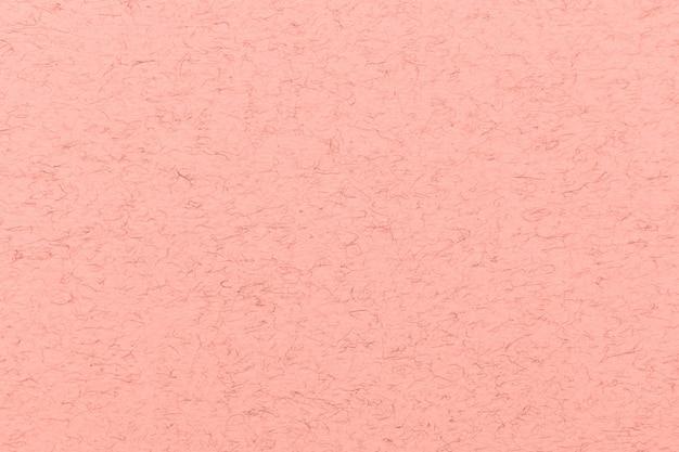 Korallenrote rosa musterbeschaffenheit. papier mit kleinen haaren oder kratzern.