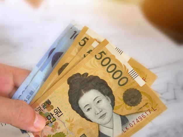 Koreanisches geld auf finanzkonto hintergrund.