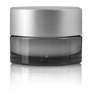 Kosmetische creme im behälter lokalisiert auf weiß