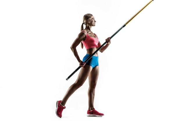 Kraft und schönheit und reinheit. professionelles weibliches stabhochspringertraining an der weißen wand. fit und schlankes weibliches modell üben. konzept des sports,