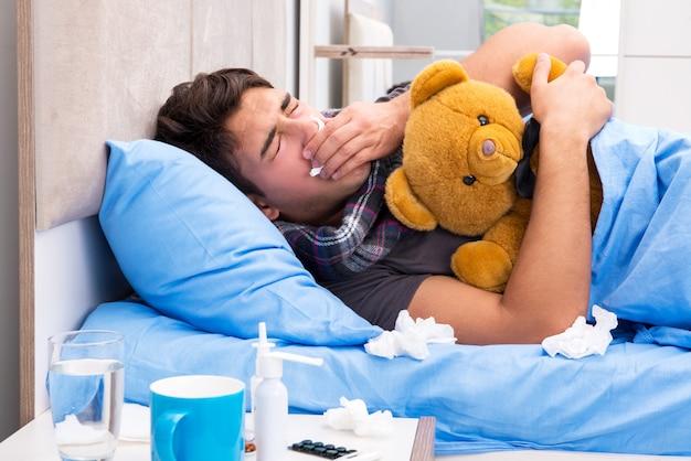 Kranker mann mit grippe im bett liegend