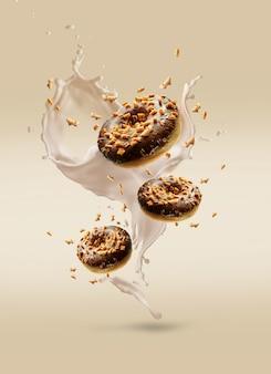 Kreative komposition von fliegenden donuts mit cremespritzern